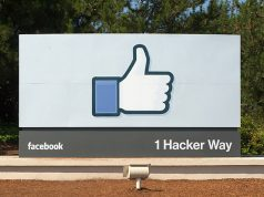 Facebook headquarters entrance sign at 1 Hacker Way, Menlo Park, California.