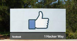 Facebook headquarters entrance sign at 1 Hacker Way, Menlo Park, California.